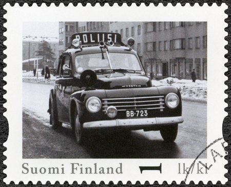 pv: FINLAND - CIRCA 2013: A stamp printed in Finland shows Volvo PV 444, series Finland Official Vintage Police Car, circa 2013