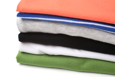 folded clothes: Folded clothes on white background Stock Photo