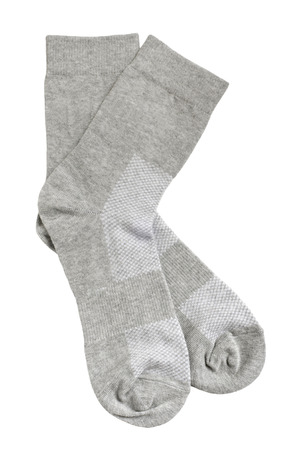 elastic garments: Pair of gray socks isolated on white background