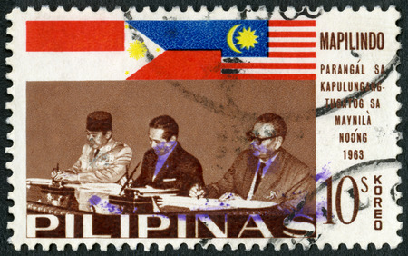 sukarno: PHILIPPINES - CIRCA 1965: A stamp printed in Philippines shows Presidents Sukarno and Macapagal and Prime Minister Tunku Abdul Rahman, Signing of the Manila Accord (Mapilindo) by  Malaya, Philippines and Indonesia, circa 1965