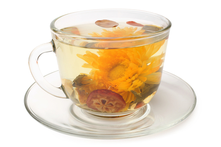 bolls: Green tea with chrysanthemum in glass cup on white background