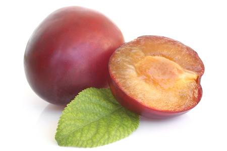 alycha: Plums with green leaf on white background