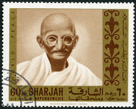 ideological: UAE - CIRCA 1970: A stamp printed in Sharjah United Arab Emirates UAE shows portrait of Mohandas Karamchand Gandhi (1869-1948), series Martyrs of Freedom, circa 1968