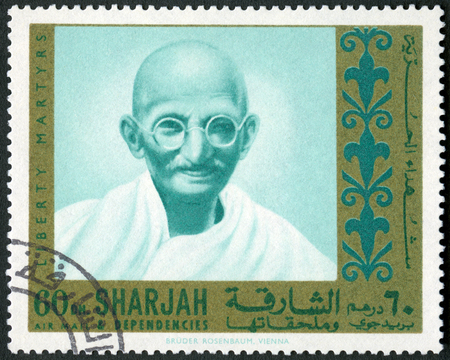 indian postal stamp: UAE - CIRCA 1970: A stamp printed in Sharjah United Arab Emirates UAE show portrait of Mohandas Karamchand Gandhi (1869-1948), series Martyrs of Freedom, circa 1968