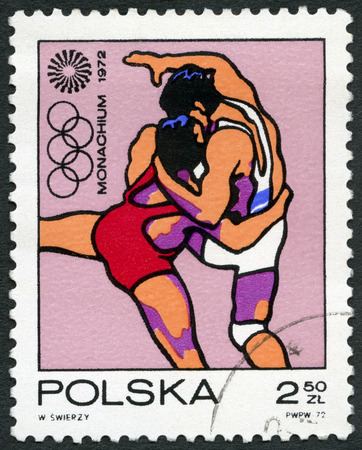 olympic symbol: POLAND - CIRCA 1971: A stamp printed in Poland shows Wrestling, Olympic Rings and Motion Symbol, series 20th Olympic Games, Munich, circa 1971