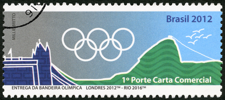 olympic rings: BRAZIL - CIRCA 2012: A stamp printed in Brazil shows Olympic Rings, London 2012- Rio 2016, 31th Olympic Games, Rio, Brazil, circa 2012