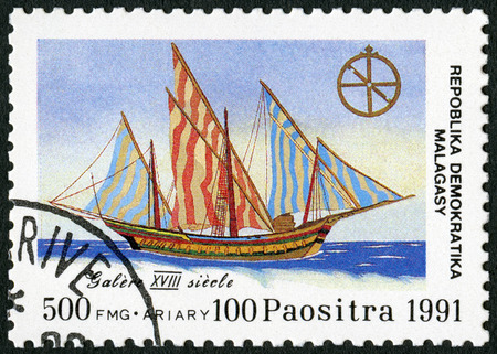 MALAGASY REPUBLIC - CIRCA 1991: A stamp printed in Malagasy (Madagascar) devoted to 500th anniversary of the discovery of America, shows Galley, 18th century, circa 1991 Editorial