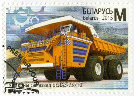 payload: BELARUS - CIRCA 2015: A stamp printed in Belarus shows BelAZ 75710, worlds largest, highest payload capacity haul truck, series Machine Building of Belarus, circa 2015