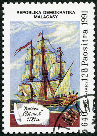 sailer: MALAGASY REPUBLIC - CIRCA 1991: A stamp printed in Malagasy (Madagascar) devoted to 500th anniversary of the discovery of America, shows Galleon Ostrust, 1721, circa 1991
