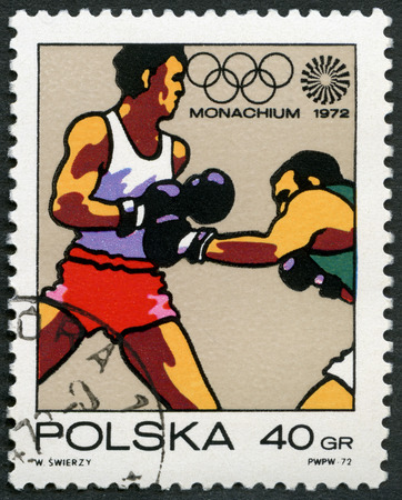 olympic symbol: POLAND - CIRCA 1972: A stamp printed in Poland shows Boxing, Olympic Rings and Motion Symbol, series 20th Olympic Games, Munich, circa 1972 Editorial