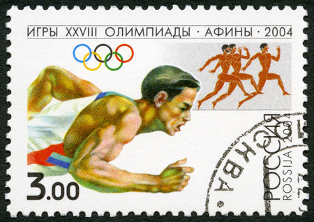 olympiad: RUSSIA - CIRCA 2004: A stamp printed in Russia shows Runner, series 2004 Summer Games Olympics, Athens, circa 2004
