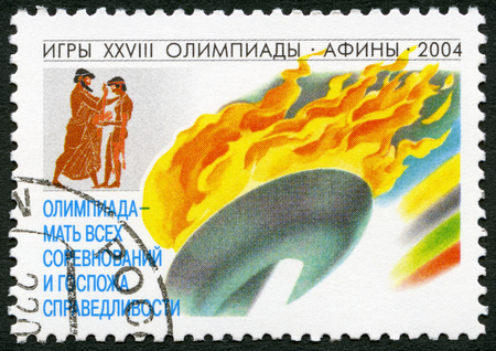 olympic symbol: RUSSIA - CIRCA 2004: A stamp printed in Russia shows the Olympic flame, series 2004 Summer Games Olympics, circa 2004