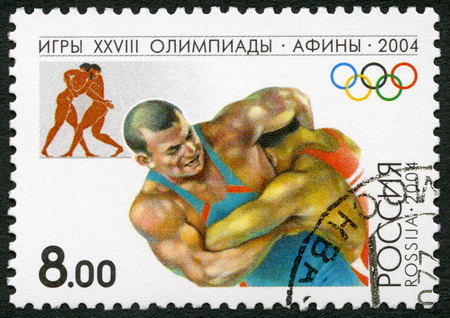 olympics: RUSSIA - CIRCA 2004: A stamp printed in Russia shows Wrestling, series 2004 Summer Games Olympics, Athens, circa 2004
