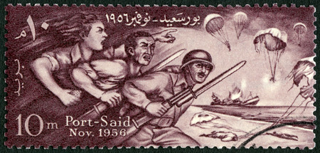 egypt revolution: EGYPT - CIRCA 1956: A stamp printed in Egypt shows Egyptians Defending Port Said, Honoring the defenders of Port Said, circa 1956