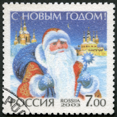 russian federation: RUSSIA - CIRCA 2003: A stamp printed in Russia shows Santa Claus, devoted Happy New Year, circa 2003 Editorial