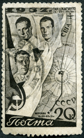 aviators: USSR - CIRCA 1938: A stamp printed in USSR shows Aviators Gromov, Danilin, Yumashev and Flight Route, First Trans-Polar flight, June 18-20, 1937, from Moscow to San Jacinto, circa 1938 Editorial