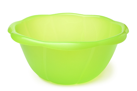 Green plastic wash bowl on white background Stock Photo