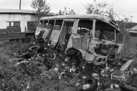 junked: Old rusty bus. Black-and-white photo.