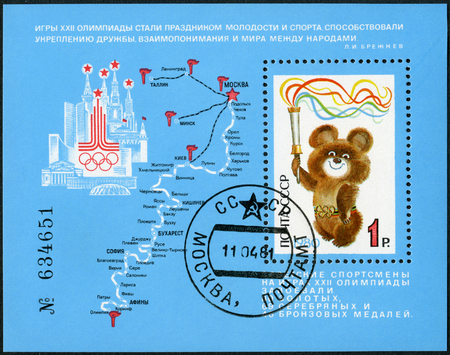 USSR - CIRCA 1980: A stamp printed in USSR shows the emblem of the Olympic Games 1980, Mischa Holding Olympic Torch, Completion of 22nd Summer Olympic Games, Moscow, July 19 - Aug 3, circa 1980 Editorial