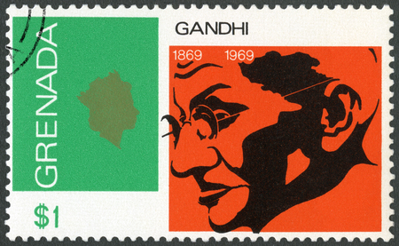 ideological: GRENADA - CIRCA 1969: A stamp printed in Grenada shows portrait of Mohandas Karamchand Gandhi (1869-1948), anniversary 100 years of Mahatma Gandhi, leader in India fight for independence, circa 1969 Editorial