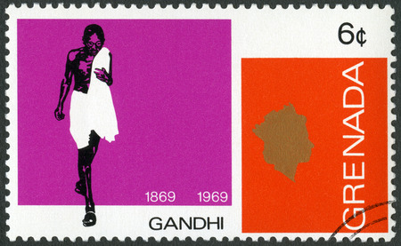 nonviolent: GRENADA - CIRCA 1969: A stamp printed in Grenada shows portrait of Mohandas Karamchand Gandhi (1869-1948), anniversary 100 years of Mahatma Gandhi, leader in India fight for independence, circa 1969 Editorial