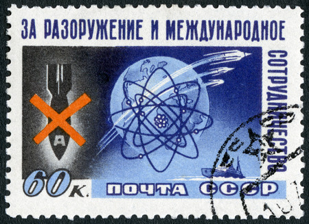 atomic energy: USSR - CIRCA 1958: A stamp printed in USSR shows Bomb, Globe, Atom, Sputniks, Ship, Conference for peaceful uses of atomic energy, held at Stockholm, circa 1958 Editorial