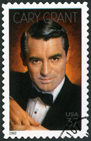 USA - CIRCA 2002: A stamp printed in USA shows Cary Grant born Archibald Alexander Leach (1904-1986), actor, circa 2002 Editorial