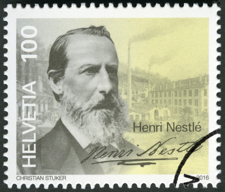 heinrich: SWITZERLAND - CIRCA 2016: A stamp printed in Switzerland shows Heinrich Henri Nestle (1814-1890), circa 2016