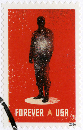 UNITED STATES OF AMERICA - CIRCA 2016: A stamp printed in USA shows the silhouette of a crewman in a transporter, circa 2016