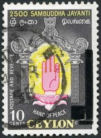 samsara: CEYLON - CIRCA 1956: A stamp printed in Ceylon shows Hand of Peace, 2500th anniversary of the birth of Buddha, circa 1956 Editorial