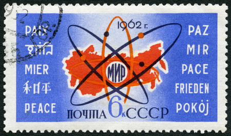 energy symbol: USSR- CIRCA 1962: A stamp printed in USSR shows Map of USSR, atom symbol and Peace in 10 languages, use of atomic energy for peace, circa 1962
