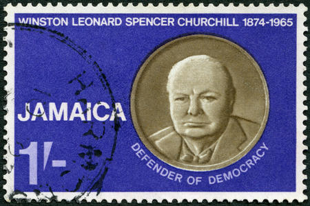 JAMAICA - CIRCA 1966: A stamp printed in Jamaica shows Sir Winston Spencer Churchill (1874-1965), statesman and WWII leader, Defender of Democracy, circa 1966