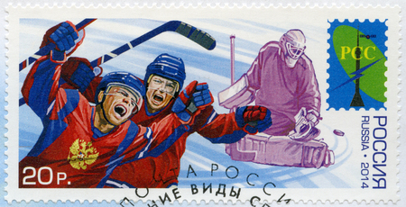 icehockey: RUSSIA - CIRCA 2014: A stamp printed in Russia shows Ice Hockey players, series Winter Sports, circa 2014