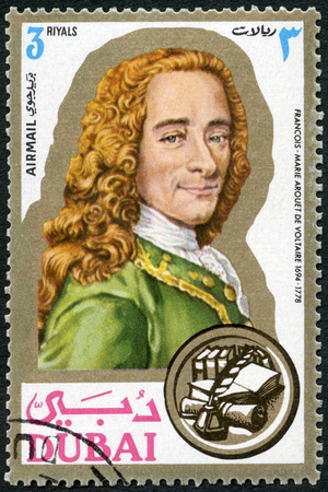 DUBAI - CIRCA 1971: A stamp printed in Dubai shows Francois Marie Arouet de Voltaire (1694-1778), writer, portraits, circa 1971
