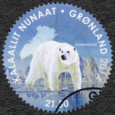GREENLAND - CIRCA 2014: A stamp printed in Greenland shows polar bear, Pole-to-Pole, circa 2014 Editorial