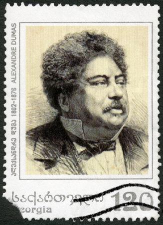 alexandre duma: GEORGIA - CIRCA 2003: A stamp printed in Georgia shows Alexandre Dumas Pere (1802-1870), French Novelist, circa 2003 Editorial