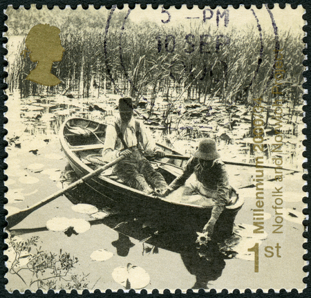 postmark: GREAT BRITAIN - CIRCA 1999: A stamp printed in Great Britain shows People in rowboat, Norfolk and Norwich Project, Newport, series Millennium 2000, Mind and Matter, circa 1999