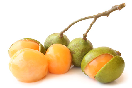 Quenepa fruit on white background