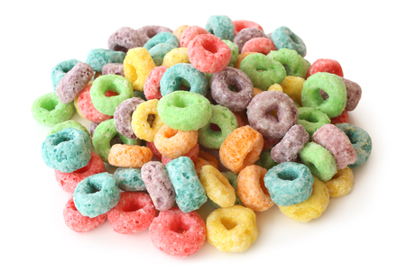 Round colorful cereal on white background