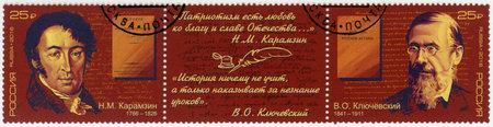 RUSSIA - CIRCA 2016: A stamp printed in Russia shows Vasiliy Kluchevskiy (1841-1911) and Nikolai Karamzin (1766-1826), Historians, series Outstanding Historians of Russia, circa 2016