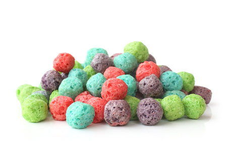 Colorful cereal balls on white background
