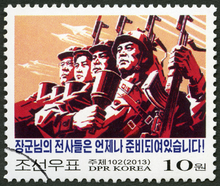 NORTH KOREA - CIRCA 2013: A stamp printed in North Korea shows Soldiers, Against Imperialism, circa 2013 Editorial
