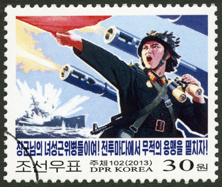 NORTH KOREA - CIRCA 2013: A stamp printed in North Korea shows Soldier, Against Imperialism, circa 2013 Editorial