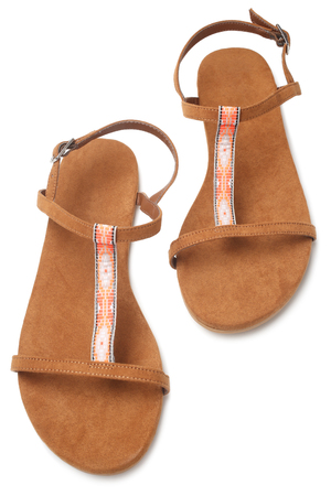 Pair of womans summer sandals on white background