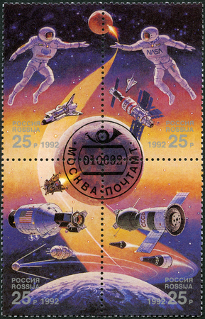 RUSSIA - CIRCA 1992: A stamp printed in Russia shows Astronaut, Russian space station and space shuttle, Space exploration, The International Space Year, circa 1992
