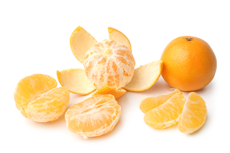 Clementines whole, peeled, halved and sectioned on white background