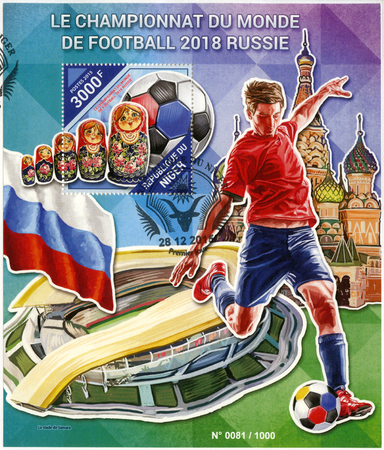 NIGER - CIRCA 2015: A stamp printed in Niger shows footballer and matreshka, 2018 Football World Cup Russia, circa 2015 Editorial