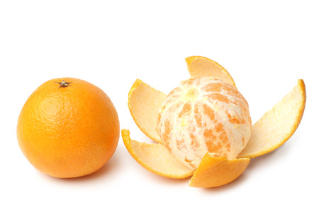 Clementines whole and peeled on white background Stock Photo