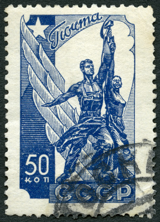 USSR - CIRCA 1938: A stamp printed in USSR shows Worker and Peasant monument, circa 1938 Editorial