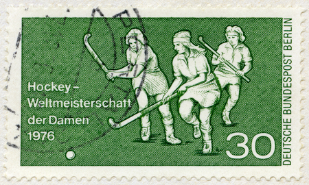GERMANY - CIRCA 1976: A stamp printed in Germany shows Field hockey, Women's World Hockey Championships, circa 1976 Editorial